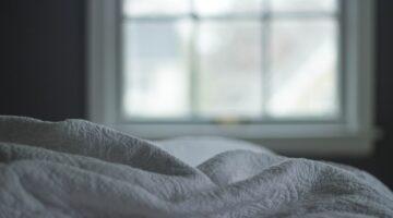 white linen bed sheet